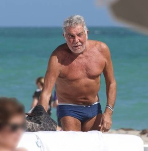 Roberto Cavalli was relaxing and soaking up the sun with his younger girlfriend Lina Nilson. Pictured: Roberto Cavalli  Ref: SPL664205  071213   Picture by: MCCFL / Splash News Splash News and Pictures Los Angeles:	310-821-2666 New York:	212-619-2666 London:	870-934-2666 photodesk@splashnews.com