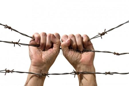 depositphotos_38864637-stock-photo-hand-behind-barbed-wire